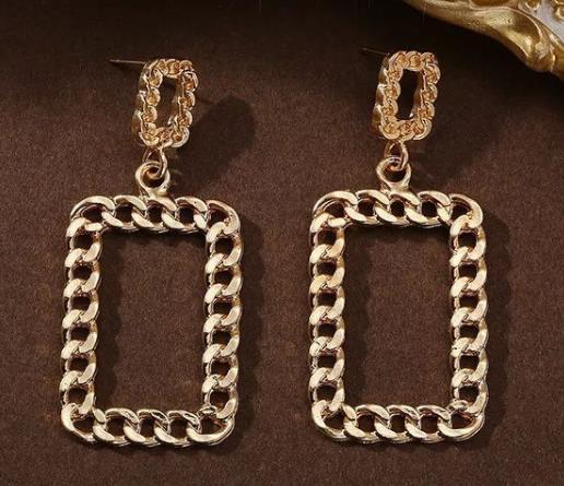 стильные серьги геометрических форм из серебра